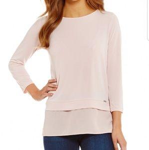 Pink tunic blouse by Ivanka Trump